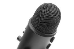 Isolerad svart mikrofon Arkivfoton