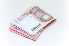 Isolerad thailändsk valuta i bakgrund och Royaltyfria Foton