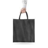 Isolerad tom svart modell för design för bomullsecopåse och att rymma handen fotografering för bildbyråer