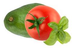 Isolerad tomat med den basilikasidor och avokadot Royaltyfria Bilder