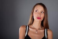 isolerad ung härlig kvinna Fotografering för Bildbyråer
