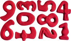 Isolerad uppsättning av nummer för röd lera Arkivbilder