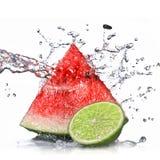 Isolerad vattenmelon-, limefrukt- och vattenfärgstänk Royaltyfri Fotografi