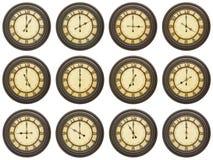 Isolerad vit collage för tappning 12 klockor Arkivbilder