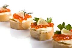 isolerad white för canape kaviar fotografering för bildbyråer