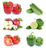 Isolerade äppletomater för frukter och för grönsaker sätter en klocka på samlingen p Royaltyfri Bild