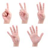 Isolerade barnhänder visar numret Royaltyfri Foto