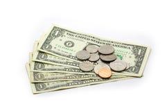 $1 isolerade biljetter och mynt - Arkivbild
