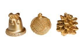 Isolerade dekorativa objekt för guld- jul Royaltyfri Foto