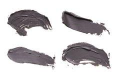 Isolerade det ansikts- maskeringssuddet för blå lera på vit bakgrund fotografering för bildbyråer
