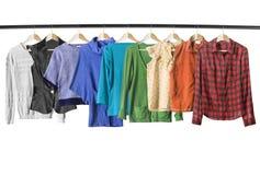 Isolerade färgrika skjortor Fotografering för Bildbyråer