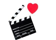 Isolerade filmclapperbräde och röd hjärta Fotografering för Bildbyråer