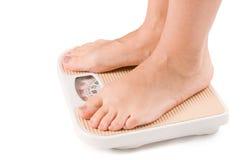 isolerade foten kvinnlig scales Fotografering för Bildbyråer