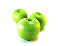 Isolerade gröna äpplen Arkivfoto