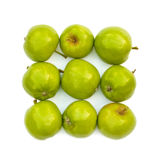 Isolerade gröna äpplen Arkivbild