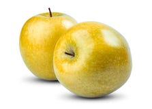 Isolerade gula äpplen på vit bakgrund nytt Fotografering för Bildbyråer