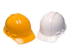 Isolerade hårda hattar för konstruktion Arkivfoto