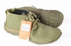 Isolerade kängor och skor Arkivfoto
