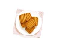 isolerade kakor plate white Fotografering för Bildbyråer