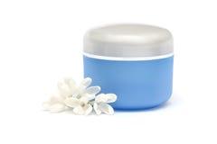 isolerade kosmetiska blommor för flaska white arkivfoton