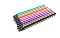 Isolerade kulöra pennor Arkivbild