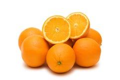 isolerade många apelsiner Arkivfoto