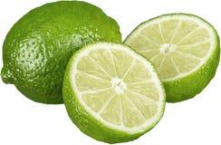 Isolerade nya och mogna limefrukter - Royaltyfria Bilder