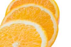 isolerade orange skivor Arkivfoto