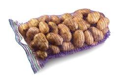 Isolerade potatisar i purpurfärgat raster Royaltyfria Bilder