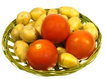 Isolerade potatisar och tomater Arkivfoto