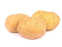 isolerade potatisar tre arkivfoton