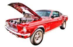 Isolerade röda Ford Mustang på vit bakgrund Fotografering för Bildbyråer