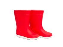 Isolerade röda rainboots Gummistöveler för ungar Royaltyfria Bilder