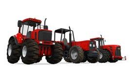Isolerade röda traktorer Arkivfoto