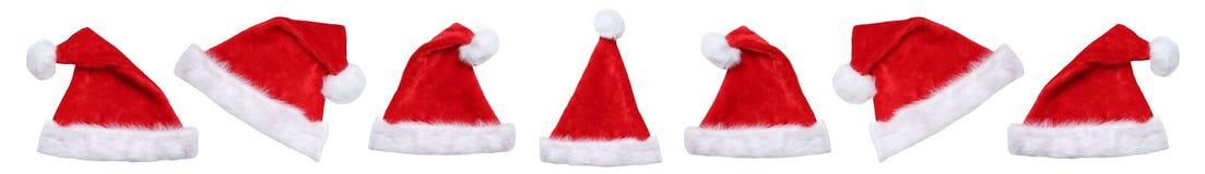 Isolerade Santa Claus hatthattar på julvinter royaltyfri fotografi