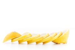 Isolerade skivade gula citroner Fotografering för Bildbyråer