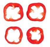 Isolerade skivor av röd peppar arkivfoto