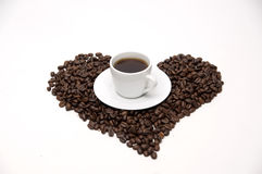 isolerade täta kaffekorn för bakgrund fotoet upp white Arkivbild