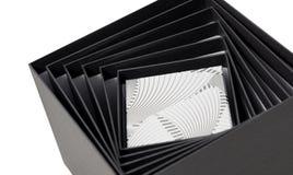 Isolerade tom öppen vit sammansättning för den svarta asken spiral Arkivfoto