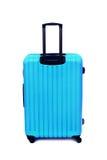 Isolerat blått bagage arkivfoton