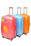 Isolerat blått orange bagage för rosa färger royaltyfri bild