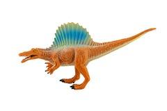 Isolerat diagram för Spinosaurs dinosarusleksak på vit bakgrund royaltyfria bilder