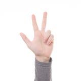 Isolerat finger för handräkningstecken tre Arkivfoto