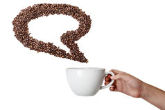 Isolerat handinnehavkopp och kaffe Bean Speech Bubble Royaltyfri Bild