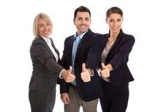 Isolerat lyckat affärslag: man och kvinna med tummar upp Royaltyfri Foto