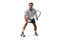 Isolerat på den vita unga mannen spelar tennis Arkivfoton