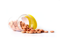Isolerat på vit bakgrund, orange preventivpillermedicin för pataint Royaltyfri Fotografi