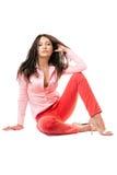 isolerat rött sexigt kvinnabarn för jeans arkivfoton
