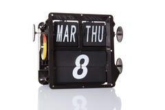 Isolerat retro datum för mekanisk kalender Fotografering för Bildbyråer