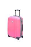 Isolerat rosa bagage Arkivfoton